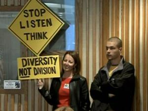 Protesters speak out on Tuesday, March 2, 2010, against the school board's proposal for neighborhood schools, which would end the school system's decade-old diversity policy.