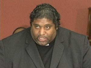 "State NAACP President Rev. William Barber calls the Wake County school board's decision to move toward community-based schools a ""public emergency."""