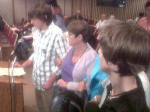 A student speaker locked arms with others in front of the Wake County Board of Education Tuesday, Aug. 10, 2010.