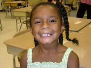Tava smiles on her first day of first grade.