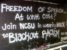 About 40 North Carolina State University students also stood locked arm-in-arm, sang and blocked the Free Expression Tunnel late Wednesday, Nov. 3, 2010. They protested racist and homophobic graffiti involving President Barack Obama that was spray-painted on the tunnel.