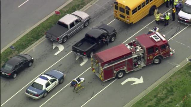 A black pickup truck hit a school bus Tuesday carrying 24 students from Wake Early College High School. There was no immediate report on whether anyone was injured.