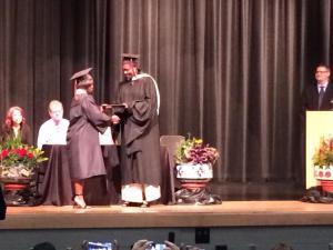 De'Nique Pickering accepts her diploma.