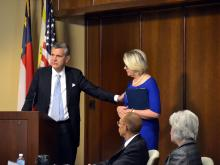 UNC Board of Governors Chairman John Fennebresque congratulates Margaret Spellings on Oct. 23, 2015, after the board names her president of the UNC system.