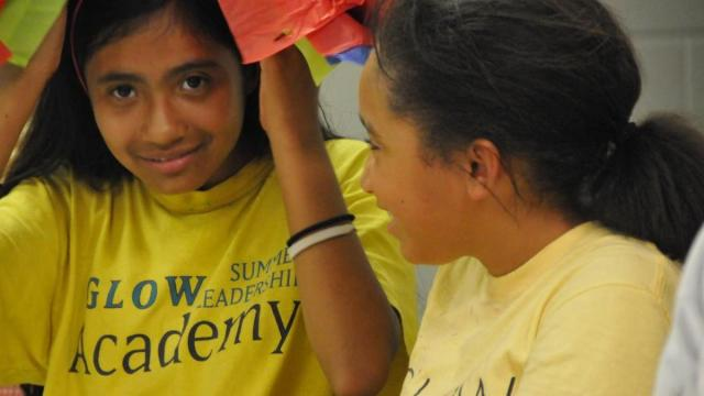 GLOW students created bright paper bows for a celebration at the end of their summer bridge camp.