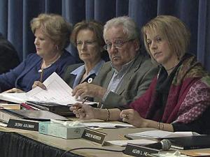 School board member Deborah Prickett, Interim Superintendent Donna Hargents, board Chairman Ron Margiotta and board Vice Chairwoman Debra Goldman listen during a public hearing Jan. 12, 2010, about student reassignment.