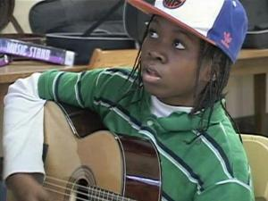 A middle schooler learns how to play the guitar as part of the Providence Afterschool Alliance, or PASA, in Providence, R.I.