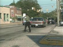 Many pedestrians cross the street in unsafe places