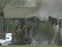 A woman died trying to get her son out of this Greensboro house after an explosion started a fire there. (WRAL-TV5 News)