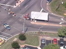 An accident at Wade Avenue & Ridge Road in Raleigh forces police to close a busy intersection. (WRAL-TV5 News)