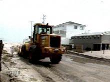 Residents Return To A Sandy Carolina Beach