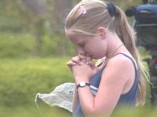 Visitors Offer Prayers and Condolences at John F. Kennedy Sr. Memorial