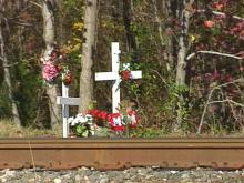 A memorial stands to serve as a reminder of those who have died at the Bashord-Hillsborough Streets railroad crossing.(WRAL-TV5 News)