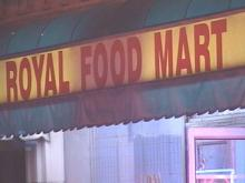 Raleigh police raced to the scene of a holdup at the Royal Food Mart convenience store on Hillsborough Street on Friday.(WRAL-TV5 News)