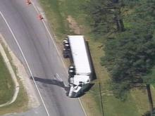 Both north and southbound lanes of I-85 at the North Carolina/Virginia border are closed after a tractor-trailer overturned Thursday morning.(WRAL-TV5 News)