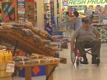 David Gamerdinger likes stores that allow him to move freely with his wheelchair. A lawsuit filed under the Americans with Disabilities Act may set a new precedent for aisle width.(WRAL-TV5 News)