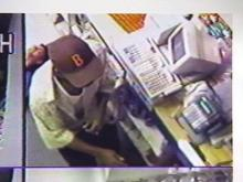 Police Search for Armed Suspect After Convenience Store Shooting, Robbery