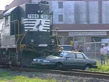A woman was injured slightly when a freight train hit her car in Durham.(WRAL-TV5 News)