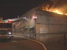 The two-story Super 10 discount store in Goldsboro went up in flames Friday evening. A fire destroyed the same store at a previous location more than two years ago.(WRAL-TV5 News)
