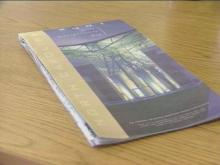 The 2001 Department of Transportation road map was unveiled Thursday. Featured on the front is a photo of the Airborne and Special Operations Museum.(WRAL-TV5 News)