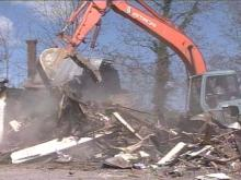 The Rocky Mount house, where seven people died in a fire, was torn down Tuesday. However, the survivors say they did not want it torn down yet.(WRAL-TV5 News)