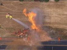 Flames from a ruptured gas line shoot into the air near Jones Franklin Road Monday.(WRAL-TV5 News)