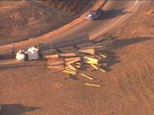 A tractor-trailer overturned Tuesday afternoon on the Inner Beltline, causing major traffic delays in the area.(WRAL-TV5 News)