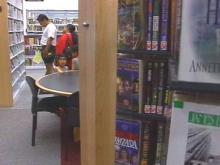 In July, the library board voted to reduce hours rather than close two branches.(WRAL-TV5 News)