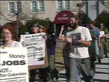 Protesters speak out against a government anti-drug program.(WRAL-TV5 News)