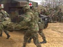 Members of the 44th Medical Brigade treated wounded soldiers on Monday, but it was not a real wartime disaster. The Warfighter training exercise replicates a war, the enemy, terrain and thousands of forces.(WRAL-TV5 News)