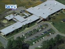 Armed Bondsmen Arrested Near Orange County School