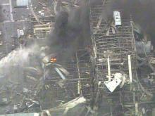 Firefighters douse the final flames at West Pharmaceutical in Kinston after a Jan. 29, 2003, explosion killed six workers and injured dozens.