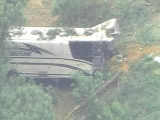 Bus Drives Off Interstate, Crashes Through Woods