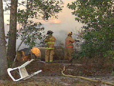 Barn Fire Still Smoldering
