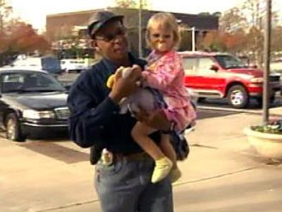 Clutching a stuffed toy, Mariah Poland, 2, is returned to her family Tuesday afternoon.