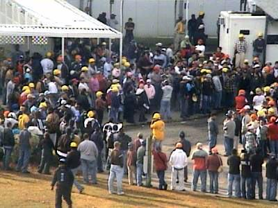 More than 300 workers walked out of a Smithfield Foods plant in Tar Heel Thursday, protesting labor practices.