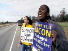 Smithfield Foods employees picketed the road to the Tar Heel plant recently, asking their fellow workers to join their walkout.