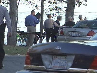 Two fishermen found the body of an unidentified male about a mile off the coast of Falls Lake on Saturday.