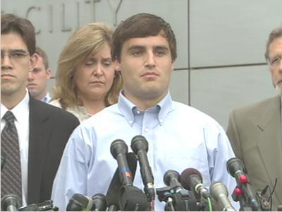 """David Evans speaks to the media before surrendering to police on May 15, one day after being indicted in connection with a rape investigation involving members of Duke University's men's lacrosse team. """"I am absolutely innocent,"""" Evans tells reporters."""