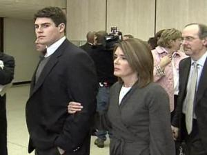 Reade Seligmann, escorted by his mother, Kathy Seligmann, enter a Durham County Courthouse courtroom Friday, Dec. 15. The courtroom was packed as Seligmann appeared for the first time with two other men accused of raping an exotic dancer.