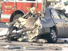 The passengers of the gold Honda Accord  -- a woman and a child -- were killed when the SUV ran over the top of the vehicle.
