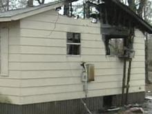 A mother and her young child are staying with family members after their house caught fire early Monday morning.