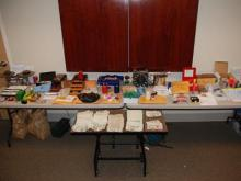 Authorities seized a large amount of cockfighting paraphernalia, including metal spurs and gaffs; illegal drugs, including cocaine, crack and marijuana; and approximately $40,000 in cash.