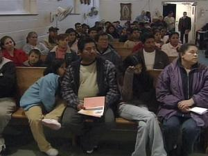 A group invited documented workers to learn about their rights under U.S. law in case they are caught up in a raid by officials seeking illegal immigrants.