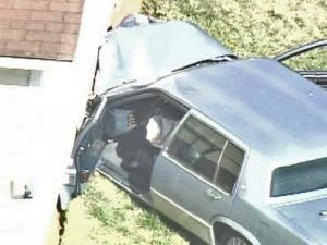 Three people were taken to WakeMed after a car crashed into a house in Raleigh.