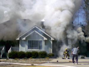 Firefighters respond to a house fire on Trace Drive in Wilson.