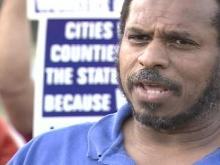 Sanitation Workers Threaten to Sue City