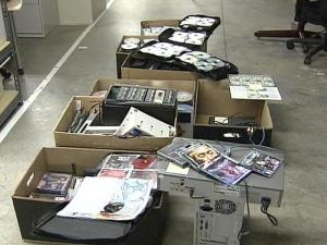 Thousands of Counterfeit Disks Seized, Woman Arrested