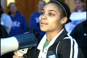 Lindsay Harding, senior guard for the Duke women's basketball team, tells fans the team wants their coach to stay away from an offer to coach the University of Texas Longhorns. The team came to a rally outside Cameron Indoor Stadium on Friday.