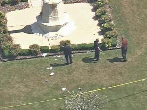 Police investigate the scene of an apparent suicide outside the VA Medical Center in Fayetteville.
